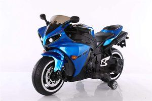 #2. TAMCO Kids Electric Blue Motorcycle with Light Training Wheels